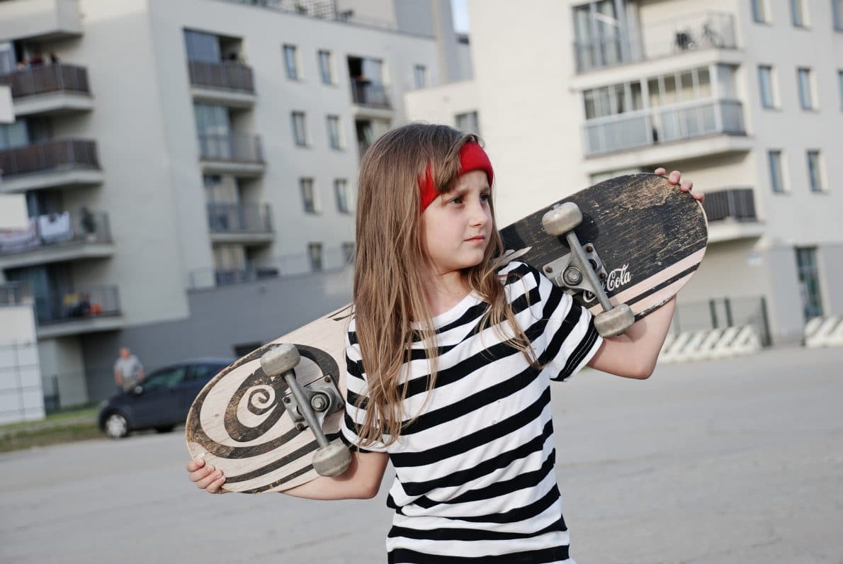 baby girl and a board