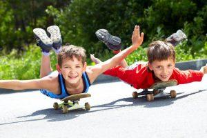 graphicstock-two-little-boys-lying-on-their-skateboards_BTGmJ_TyVZ